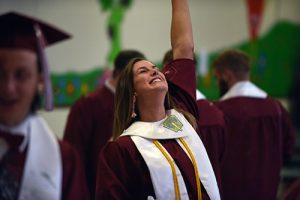 A Fort Plain celebrates after graduating.