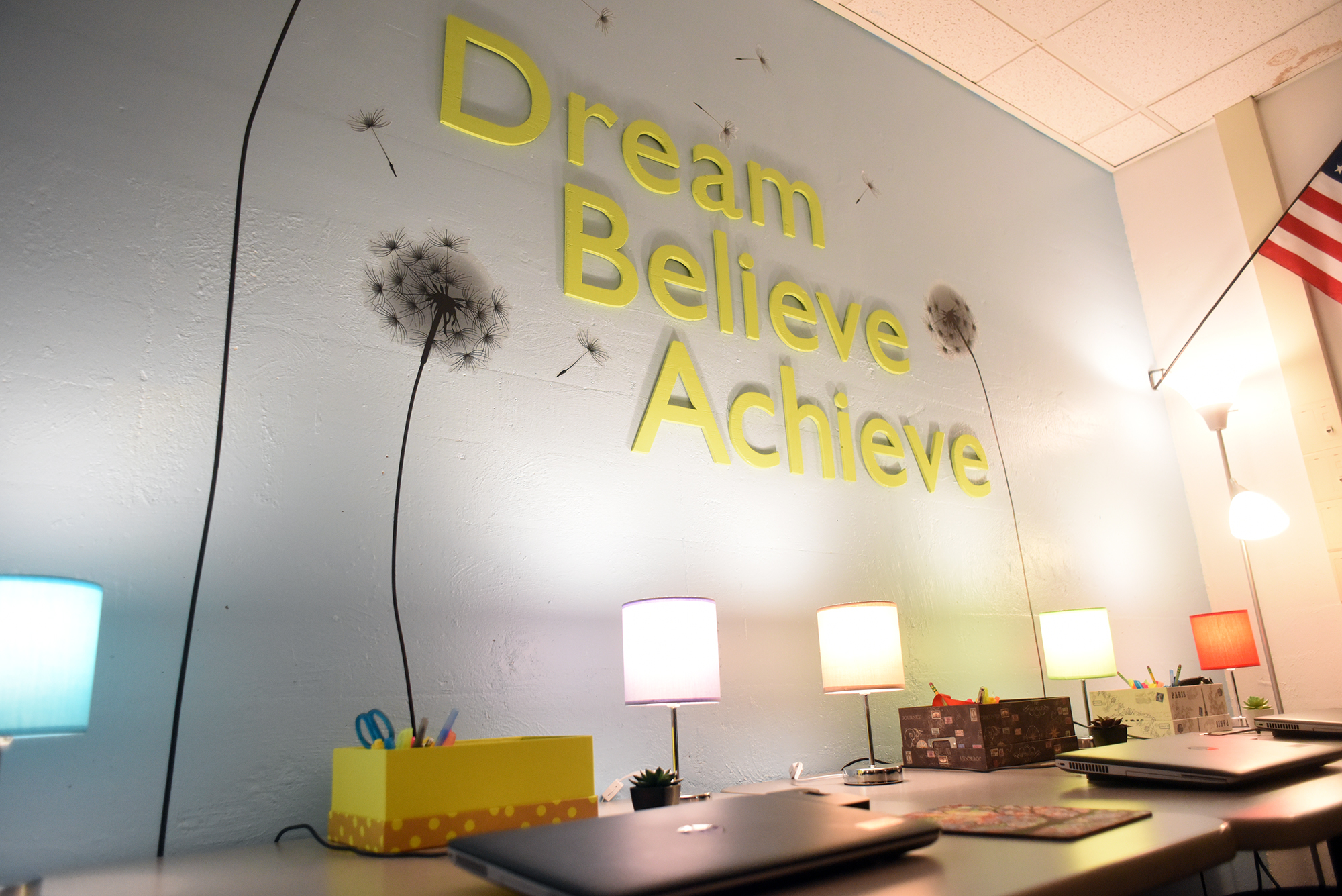 The Dream, Believe, Achieve sign in the ACC Classroom.