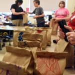 Life Skills students pack bags of food for Harry Hoag students to take home.