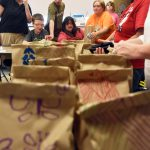Life Skills students pack up food for Harry Hoag students.