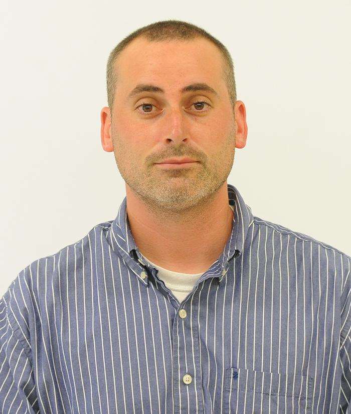 Photo of new teacher Denis DeRider