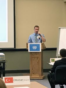 Bryce Thibodeau delivers his resolution at the Model UN