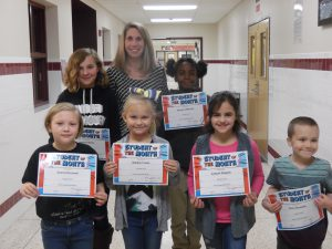students hold certificates with principal