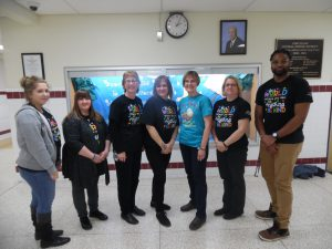 More staff at elementary school wearing autism awareness shirts