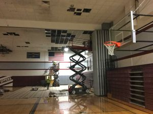 construction equipment in a school gym