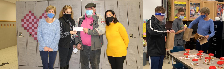 Moose $1,000 donation by Doc Davis & students working on Snack Bag program