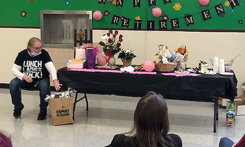 Dawn Surnear opens gifts at retirement event