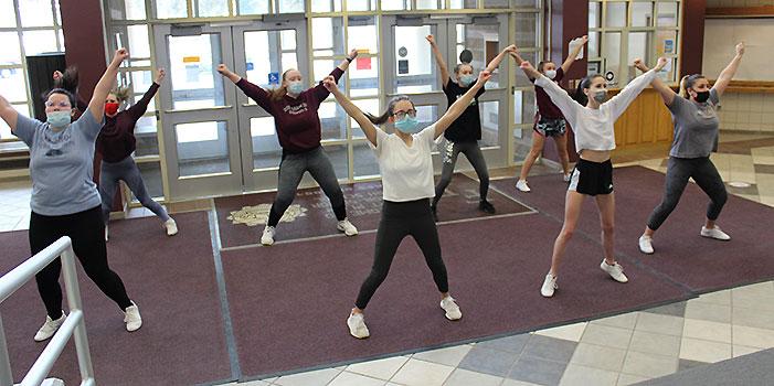 cheerleaders practicing in HS lobby