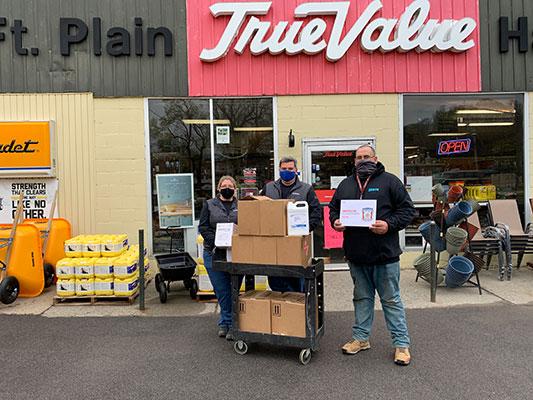 Tanya Kilmartin, Shawn Kilmartin and Matt Hearn with donations in front of store