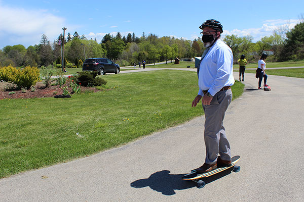 Superintendent on a longboard