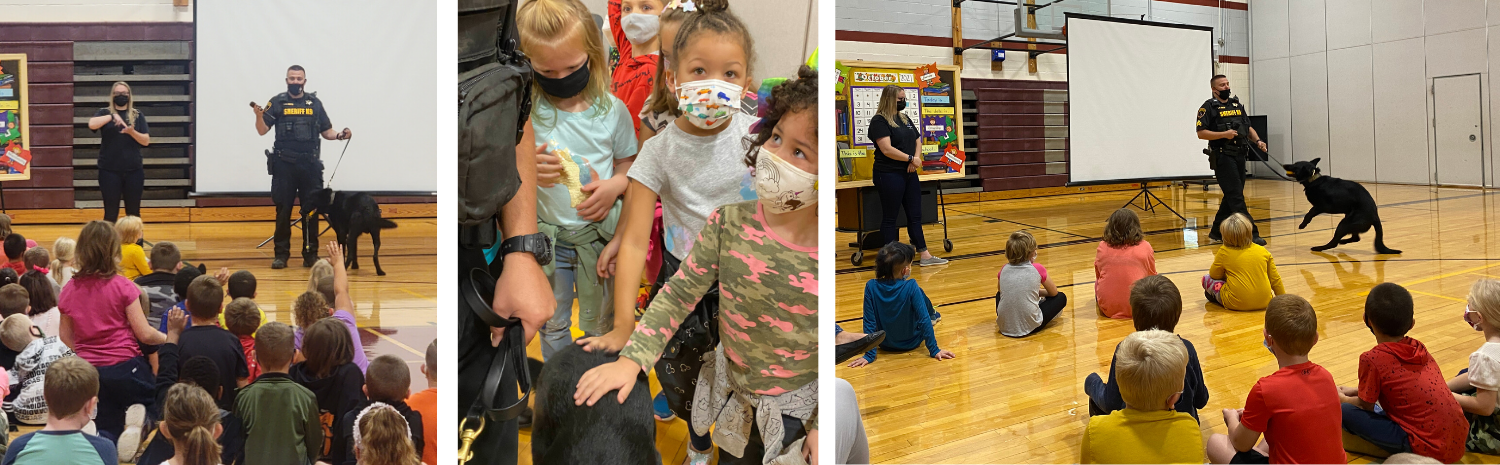children with K9 Bud and Officer Smith in gym