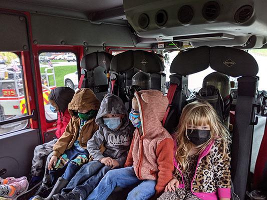 Pre-K students sitting inside a fire truck
