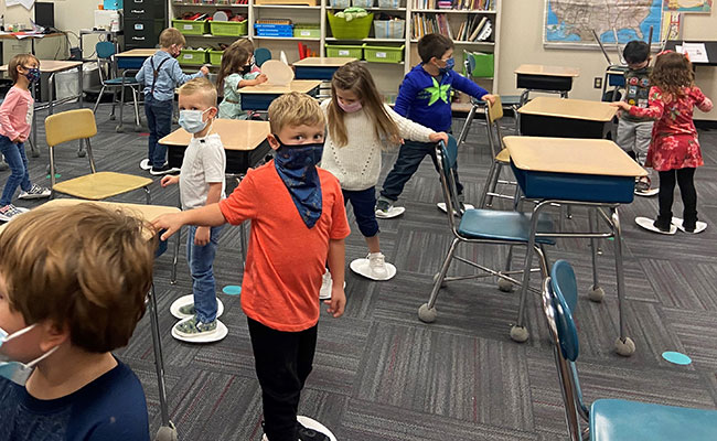 Pre-K students skating on paper plates