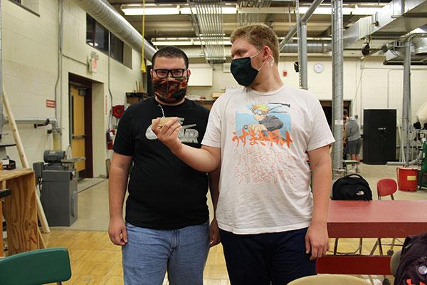 2 students holding zipper pull prototype